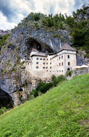 Predjama Castle, located in the village of Predjama, Slovenia, built in 1570 in the Renaissance style, situated under a natural rocky arch high in the stone wall to make access to it difficult.