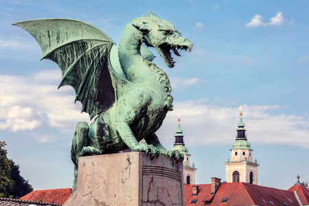 Dragon statue on the Dragon Bridge in Ljubljana, Slovenia. The bridge, decorated with the Dragon statues at four corners, was built in 1901 and since then has become a symbol of the city.