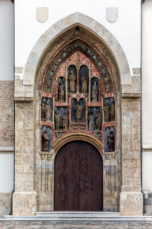 South portal of the St. Mark's Church in Zagreb, Croatia, sculpted by the Parler family from Prague at the end of the 14th century. Consists of fifteen effigies placed in eleven shallow niches. Stok Fotoğraf