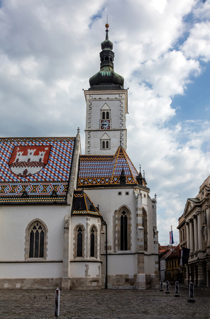 The Church of St. Mark, located in St. Mark's Square in Zagreb, Croatia, originated in the 13th century, reconstructed in the 14th century, featured the Zagreb Coat of arms on the roof. Stok Fotoğraf