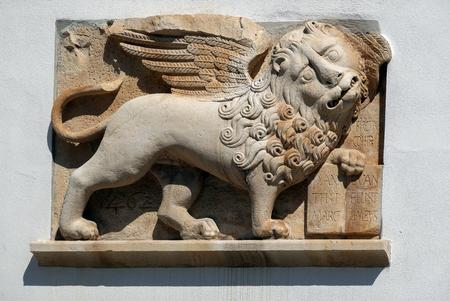 Medieval Venetian Lion of Saint Mark on the Hvar's Loggia wall in Hvar, Croatia
