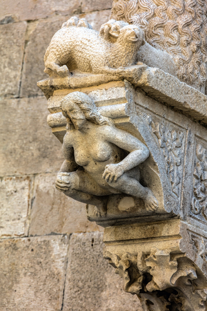 The portal of the Cathedral of Saint Mark in Korcula, Croatia, built by Bonino da Milano in 1412 contains typical Romanesque motifs such as a lion tearing its prey and a crouching figure of Eve Stock Photo
