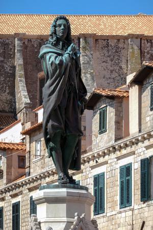 Statue of Dubrovnik poet Ivan Gundulic sculpted by Ivan Rendic in 1893.