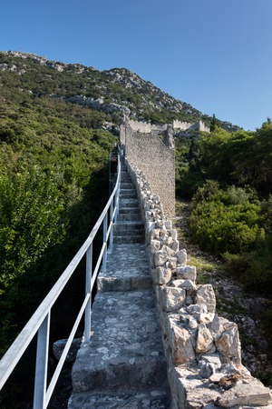 Ston, Croatia, August 1, 2018: Walls of Ston, Croatia, built in the 14th and 15th centuries, the longest defensive structure in Europe, sometimes referred to as the