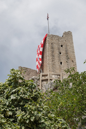 Omis, Croatia, July 28, 2018: 13th century fortress Mirabella in the town of Omis, Croatia, covered by a huge jersey of the Croatian national soccer team's player Ivan Perisic, who was born in Omis.