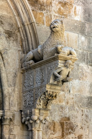 The portal of the Cathedral of Saint Mark in Korcula, Croatia, built by Bonino da Milano in 1412 contains typical Romanesque motifs such as a lion tearing its prey and a crouching figure of Adam