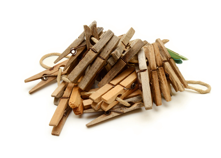 Old clothespins on white background Stock Photo