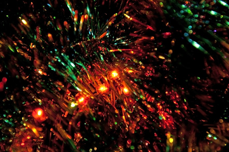 the tinsel: Tinsel and Christmas lights. Shallow depth of field