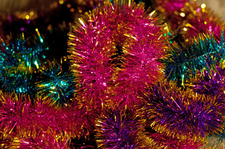 the tinsel: Colorful tinsel. Christmas blurred background Stock Photo