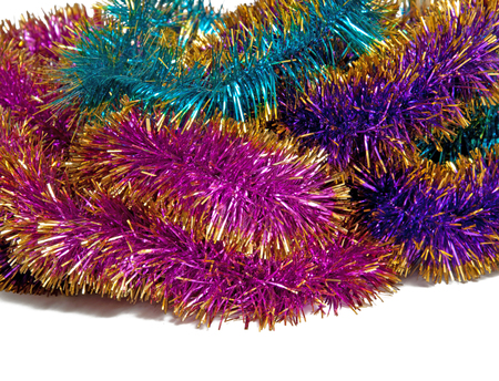 the tinsel: Colorful tinsel on a white background
