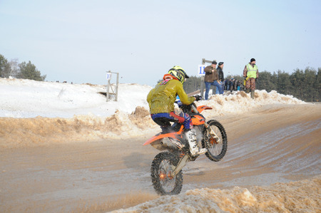 motobike: KOVROV, RUSSIA - FEBRUARY 22, 2015: Whinter motocross competitions
