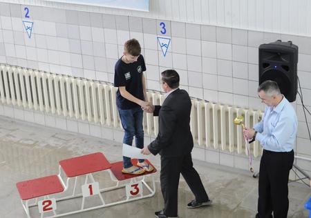 awarding: KOVROV, RUSSIA - FEBRUARY 28, 2015: Swimming competition. Awarding Editorial