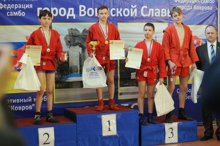 struggles: KOVROV, RUSSIA - March 14, 2015: Competitions Sambo behalf of Kovanova. Awarding
