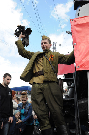 arrived: KOVROV, RUSSIA - MAY 2, 2015: Victory Train arrived at the railway station of the city of Kovrov. Participant historical reconstruction