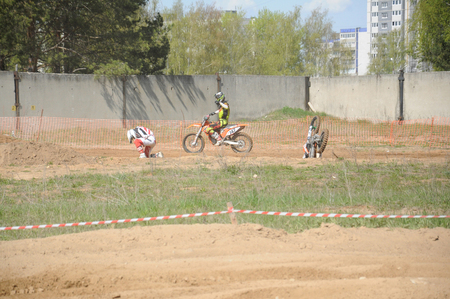 motobike: KOVROV, RUSSIA - MAY 10, 2015: Motocross competitions. Accident at the track Editorial