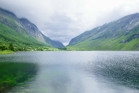 Lake in the mountains between two rocky hills