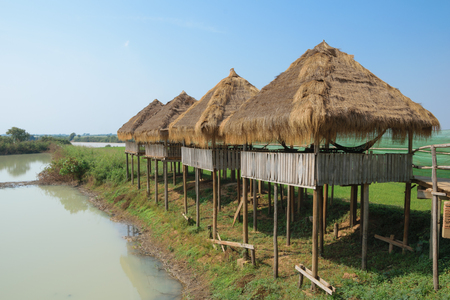 The thatched gazebo on stilts under the scorching sun