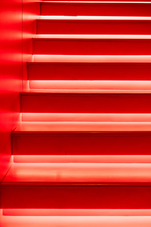 bajando escaleras: Abstract modern red stairs with warm light  - stairway composition