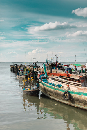 docked: Coastal view of fishing boats by a pier