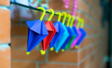 paper umbrella: Multi color umbrella origami hanging on mirror Stock Photo