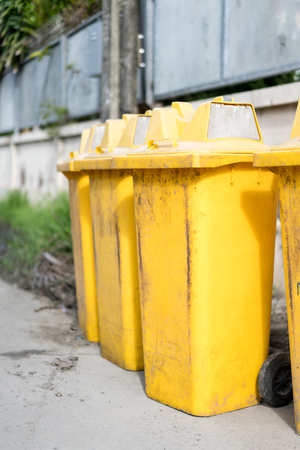 Row of public dirty trash can Stock Photo