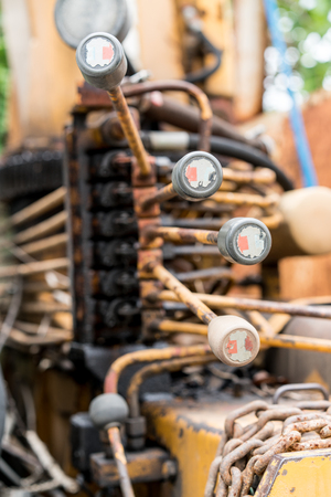 shallow: Close up old tractor controller in the shallow depth of field