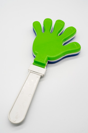 Plastic toy hand clapper green and white color isolated on white background Reklamní fotografie