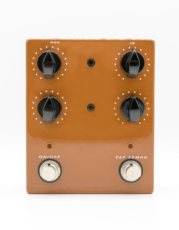 midi: Brown guitar pedal isolated on white background. Stompbox Stock Photo