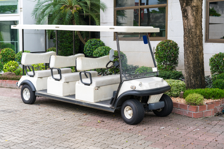 White Golf Cart With Back Seats In The Public Park Waiting For ... on golf players, golf tools, golf games, golf words, golf buggy, golf trolley, golf cartoons, golf card, golf girls, golf handicap, golf machine, golf hitting nets, golf accessories,