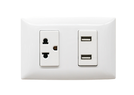 White electrical plug and USB wall outlet isolated on white background