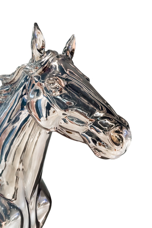 iron horse: Head of silver horse statue. Shiny metal knight with reflection isolated on white background. Sign of spirit and pride.