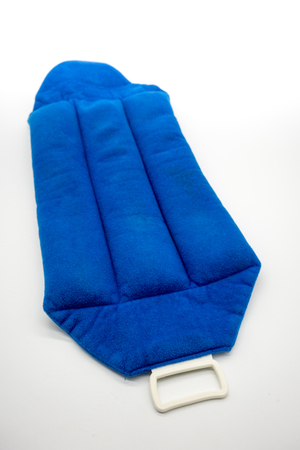 thermotherapy: Blue microwave heating pad isolated on white background. Cold and hot wrap for shoulder,  neck, back, and body pain relief therapy.