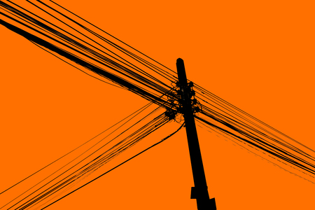 Silhouette of chaos electric cable hanging on the pole Stock Photo