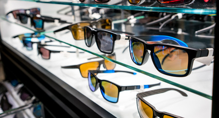 store shelf: Various of sun glasses in the shop display shelves. Selective focus