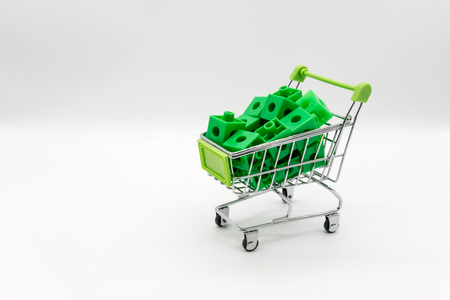 go inside: Green shopping cart with green 3d puzzle inside. Go Green concept. Stock Photo