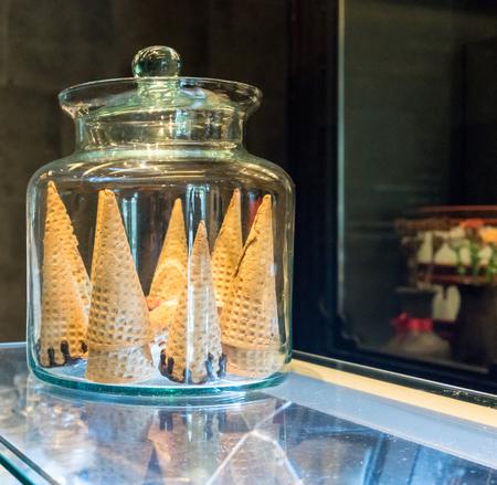 blank crispy ice cream cone in glass container