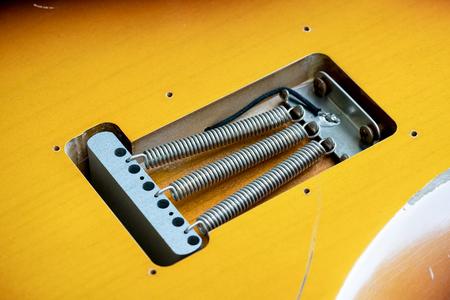 closeup of vintage electric guitar springs. Selective focus Stock Photo