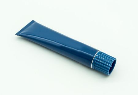 Blue cream tube isolated on white background.