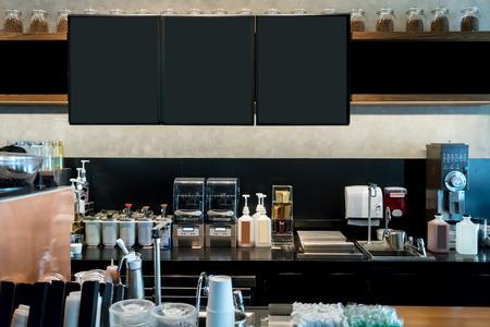 Behind the coffee bar in dark tone interior. Stock Photo