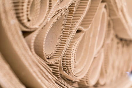 Roll of wavy craft paper folded in random. Single faced corrugated paper best useful for decoration. Selective focus