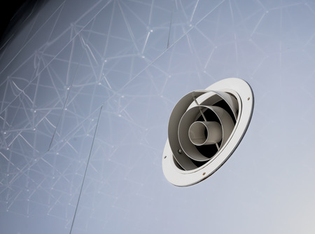 Circle grille air duct cover for air conditioning. Metal white grille for ventilation. Stock Photo