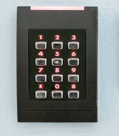numpad: A numeric keypad, Numpad, with red LED lights for staff get-in on light blue and grey background