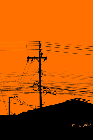 Silhouette of chaos electric cable hanging on the pole Reklamní fotografie