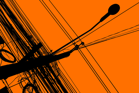 electric grid: Silhouette of chaos electric cable hanging on the pole Stock Photo