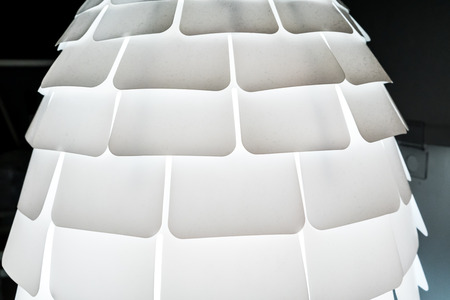 lamp shade: Modern white lamp with decorative multiple shade hanging from ceiling