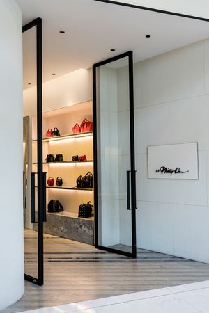 3.1 Phillip liu shop at Emquartier Thailand, Sep 3, 2017 : Luxury and fashionable brand window display. Main entrance of flagship store for casual woman clothings and bag showcase.