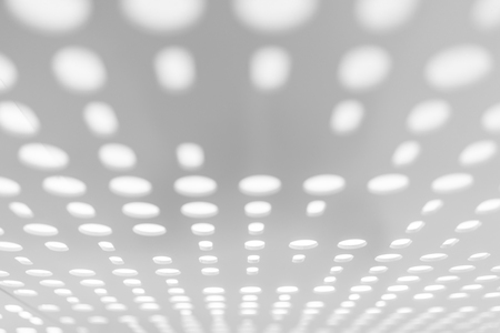 Bright light through white metal panel for blurred abstract pattern and blurred background. Perspective view. Selective focus Stok Fotoğraf