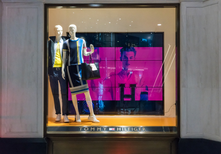 Tommy Hilfiger at Emquatier, Bangkok, Thailand, Sep 2, 2017 : Luxury and fashionable brand window display. New collection of casual clothings and accessories display at flagship store.