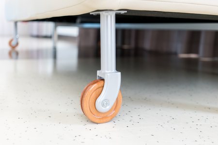 Furniture accessories. Wood wheel and metal structure for sofa and tables. Roller for furniture.