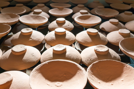 Rows of traditional clay pot lids for pattern and background.